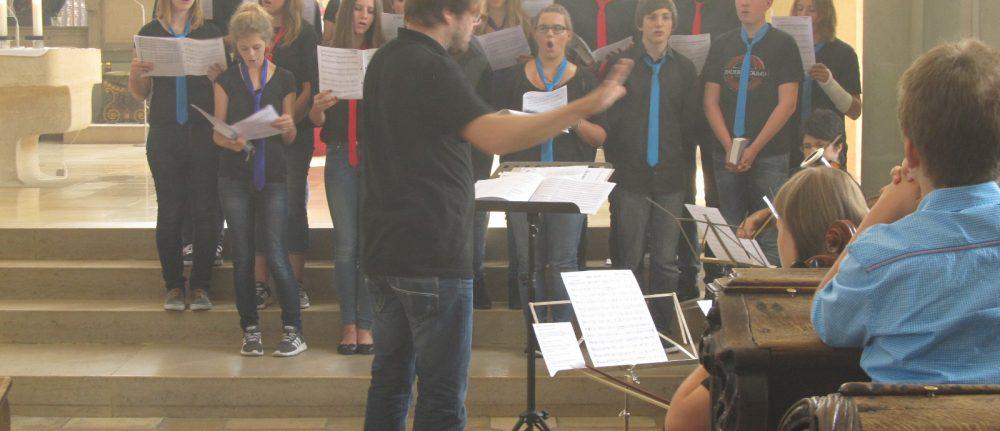 Jugendchor und Orchester geben ein Konzert in der Augsburger Ulrichsbasilika